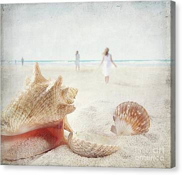 Beach Scene With People Walking And Seashells Canvas Print by Sandra Cunningham