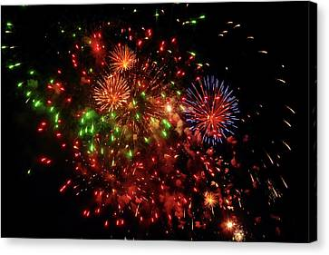 Beautiful Fireworks Against The Black Sky Of The New Year Canvas Print