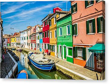 Historic Architecture Canvas Print - Blue Boat In Burano by Lisa Lemmons-Powers