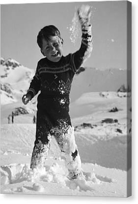 Boy Throwing A Snowball Canvas Print by German School