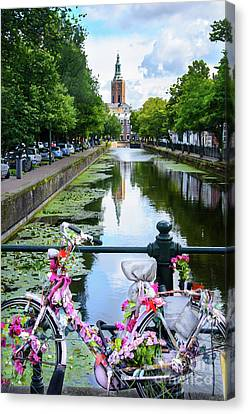 Canvas Print featuring the digital art Canal And Decorated Bike In The Hague by RicardMN Photography