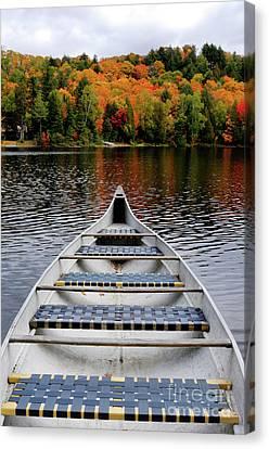 Canoe On A Lake Canvas Print by Oleksiy Maksymenko