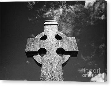 Celtic Cross In A Rural Irish Graveyard In Tydavnet County Monaghan Republic Of Ireland Canvas Print by Joe Fox