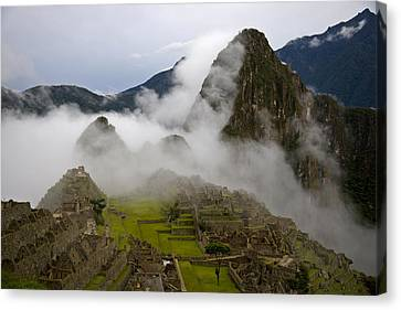 Cloud Shrouded Machu Picchu Canvas Print by Michael Melford