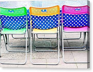 Colorful Chairs Canvas Print by Tom Gowanlock