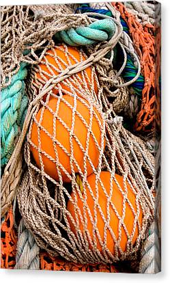 Colorful Fishing Nets And Buoys Canvas Print by Carol Leigh