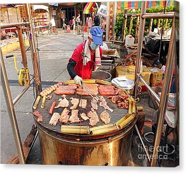 Canvas Print featuring the photograph Cooking Meat And Eggs On A Huge Grill by Yali Shi