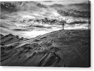 Cross On Winter Mountaintop At Sunset Canvas Print by Lukas Budimaier