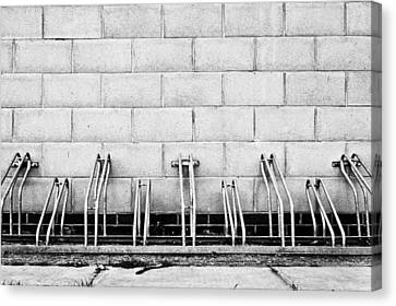 Cycle Racks Canvas Print by Tom Gowanlock