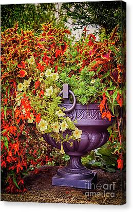 Canvas Print featuring the photograph Decorative Flower Vase In Garden by Ariadna De Raadt