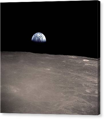 Saenger Canvas Print - Earth Rising Above The Moons Horizon by Stocktrek Images