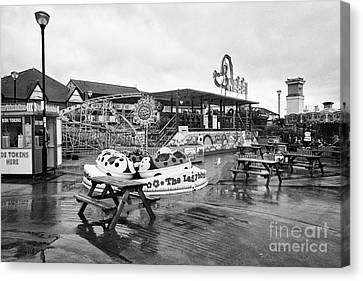 Empty Outdoor Amusement Park On A Cold Wet British Summer Day North Wales Uk Canvas Print by Joe Fox