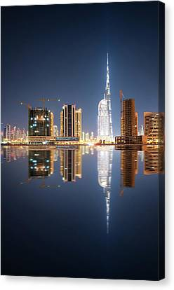 Fascinating Reflection Of Tallest Skyscrapers In Business Bay District During Calm Night. Dubai, United Arab Emirates. Canvas Print