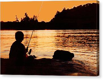 Fishing From A Rock  Canvas Print