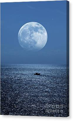 Full Moon Rising Over The Sea Canvas Print by Detlev van Ravenswaay