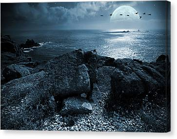 Fullmoon Over The Ocean Canvas Print by Jaroslaw Grudzinski