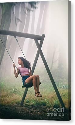 Girl In Swing Canvas Print by Carlos Caetano