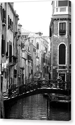 Gondola Ride In Venice Canvas Print by Greg Sharpe