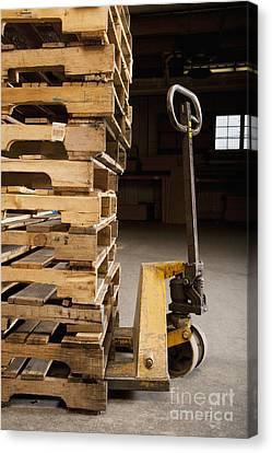 Hand Truck And Wooden Pallets Canvas Print by Shannon Fagan