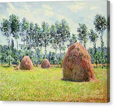 Haystacks At Giverny Canvas Print by Claude Monet