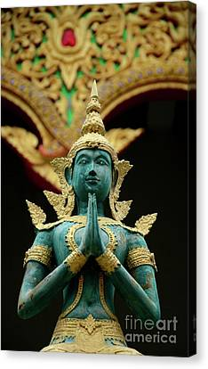 Hindu Deity Greets At Buddhist Temple Chiang Mai Thailand Canvas Print by Imran Ahmed
