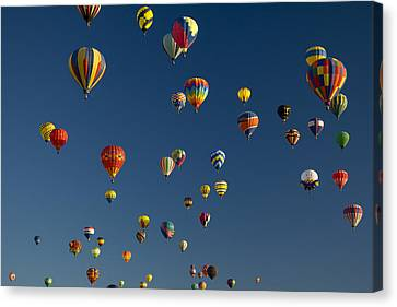 Hot Air Balloons Fly In A Hot Air Canvas Print by Ralph Lee Hopkins