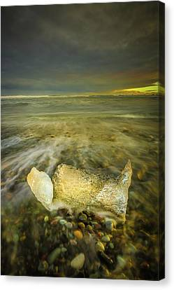 Ice In Surf At Dusk. Canvas Print by Andy Astbury