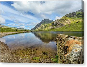 Canvas Print featuring the photograph Idwal Lake Snowdonia by Adrian Evans