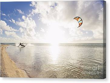 Kiteboarding In Tropical Lagoon Canvas Print by MakenaStockMedia