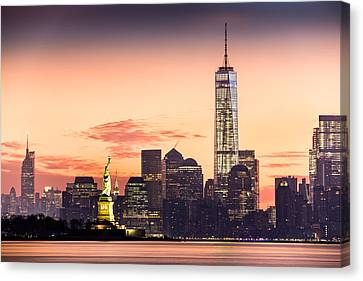 Canvas Print featuring the photograph Lower Manhattan And The Statue Of Liberty At Sunrise by Mihai Andritoiu