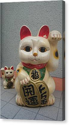 A Figure Of A Beckoning Cat, Called 'manekineko' Canvas Print