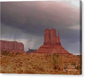 Canvas Print featuring the photograph Monument Valley - Rain Coming by Merton Allen