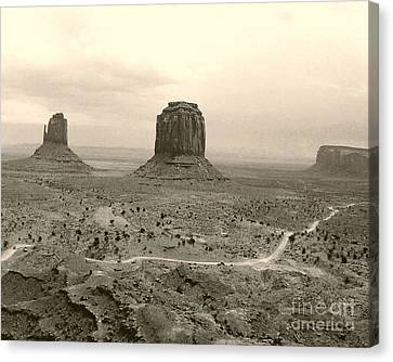 Canvas Print featuring the photograph Monument Valley Panorama At Dusk by Merton Allen