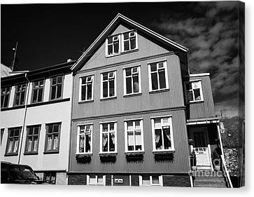 Multi Storey Brightly Painted Corrugated Iron Clad Buildings Reykjavik Iceland Canvas Print by Joe Fox
