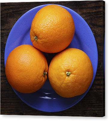 Naval Oranges On Blue Plate Canvas Print by Donald Erickson
