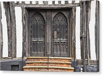 Medieval Entrance Canvas Print - Old Doors by Tom Gowanlock