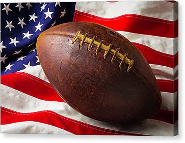 Old Football On American Flag Canvas Print by Garry Gay