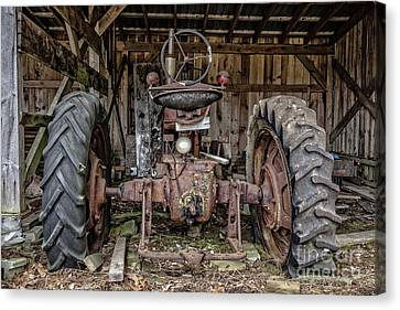 Old Tractor In The Barn Canvas Print by Edward Fielding