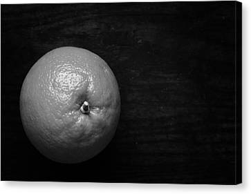 Oranges On Wood Background In Black And White Canvas Print by Donald Erickson