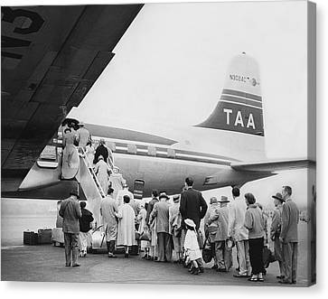 Passengers Boarding Airplane Canvas Print by Underwood Archives