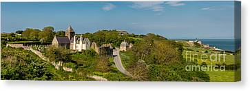 Penmon Priory Canvas Print by Adrian Evans