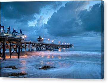 Pier In Blue Canvas Print by Gary Zuercher