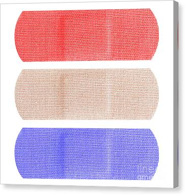 Red White And Blue Bandaids Canvas Print by Blink Images