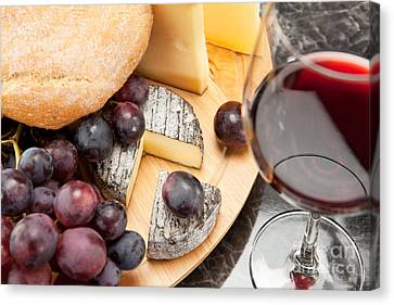 Red Wine With Wine Grapes Cheese Plate And Bread Canvas Print by Wolfgang Steiner