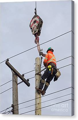 Replacing A Telephone Pole Canvas Print by Scimat