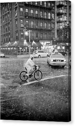 Canvas Print featuring the photograph Rider In The Rain by Dave Beckerman