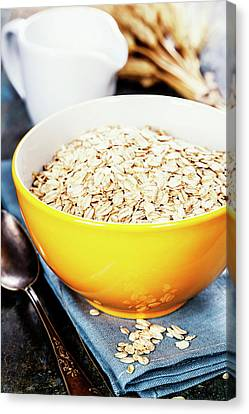 Rolled Oats In A Bowl Canvas Print by Natalia Klenova