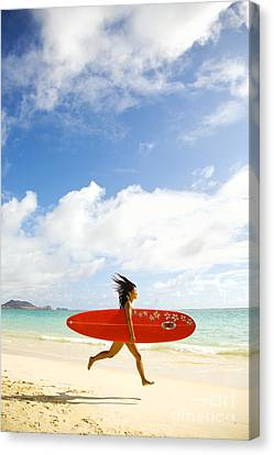 Running With Surfboard Canvas Print