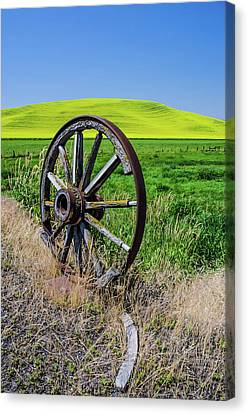 Rustic Wagon Wheel In The Palouse Canvas Print by James Hammond