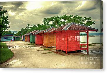 Canvas Print featuring the photograph Shacks by Charuhas Images